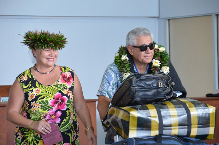 Love, actually! Returning residents welcomed home at airport